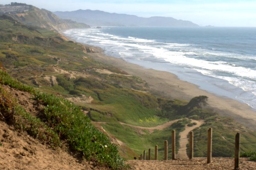 view of coastal cliffs and trails at Fort Funston Beach